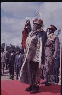 President Jomo Kenyatta salutes during the national anthem